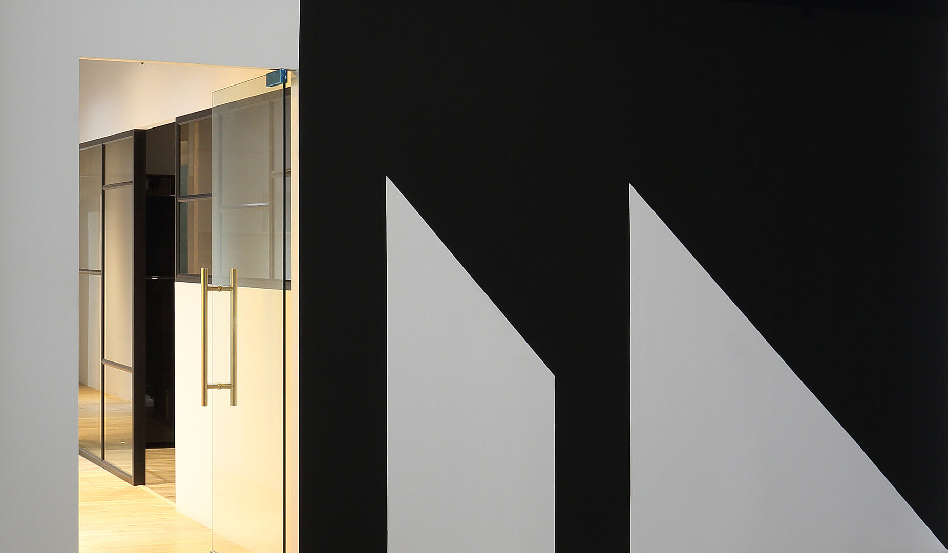 Monoloft's Design Studio Renovation Logo with Glass Door