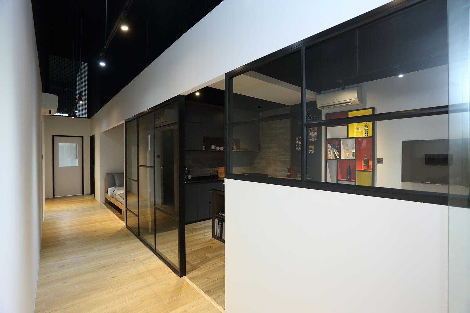 Monoloft's Design Studio Renovation Corridor with Glass Panels
