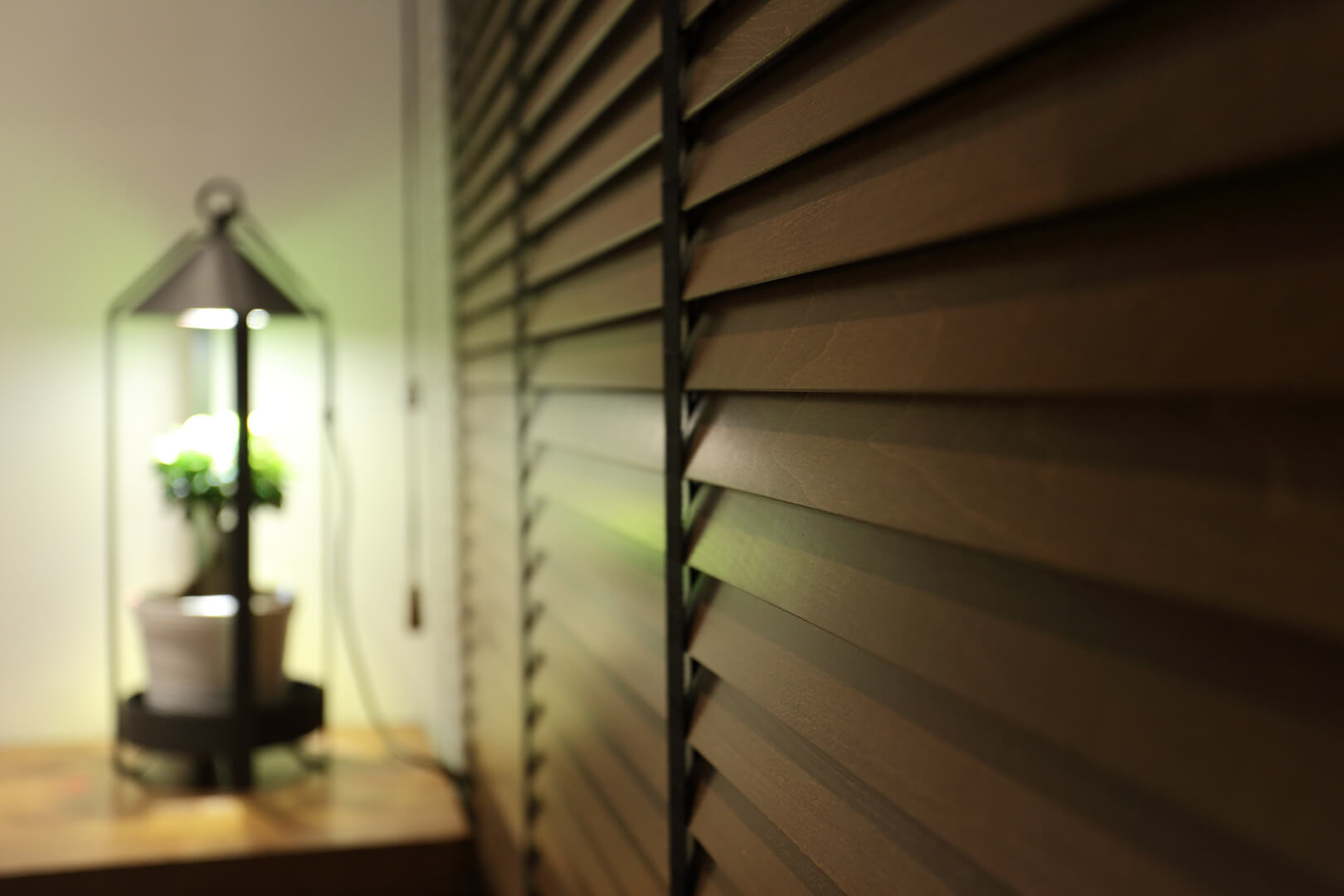 Monoloft's Design Studio Renovation Window Blind with Wooden and Lamp